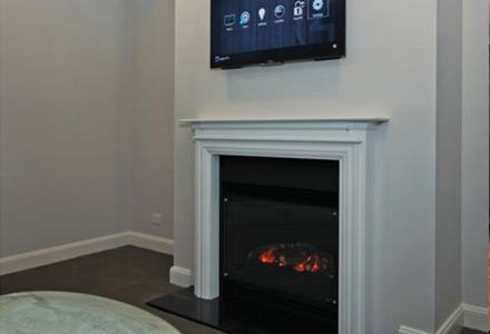 A smart fireplace which is able to be turned on and off with a Control4 touchscreen.
