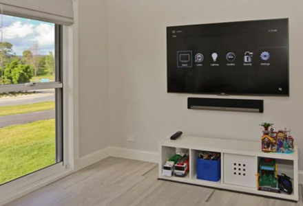 Wall-mounted TV sowing the Control4 on-screen display