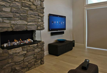 A Wall mounted TV with Sonos Playbar speaker