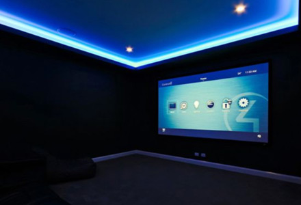 Home cinema projector screen showing the Control4 on-screen display.